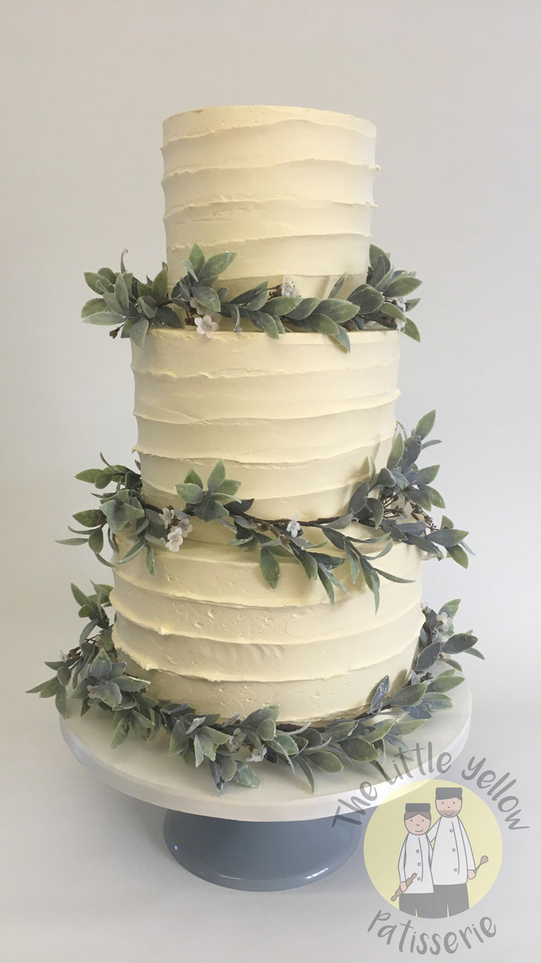 The Little Yellow Patisserie Wedding Cakes (three tier white cake with green fondant leaves)