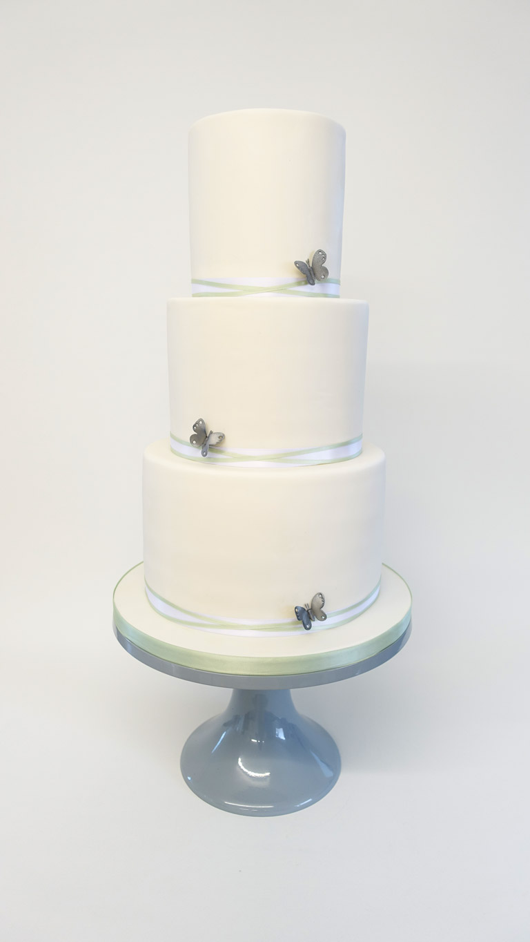 The Little Yellow Patisserie Wedding Cakes (white three tier wedding cake with small fondant butterflies)