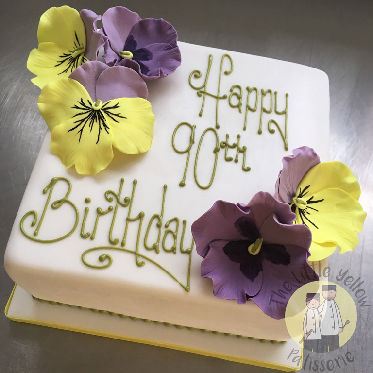 The Little Yellow Patisserie Cakes (white square cake reading Happy 90th Birthday with fondant pansies)