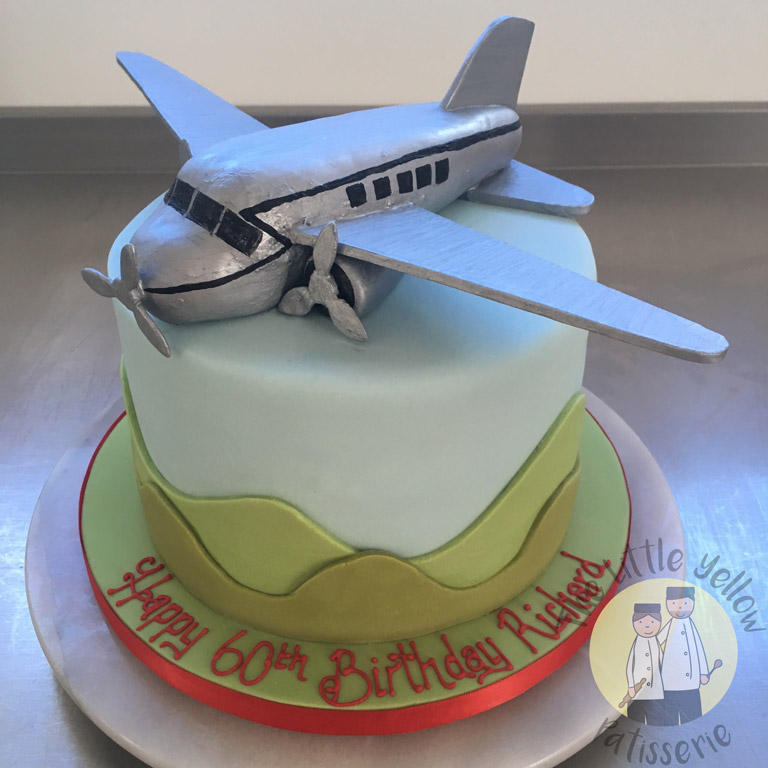 The Little Yellow Patisserie Cakes (light blue cake with fondant airplane on top)