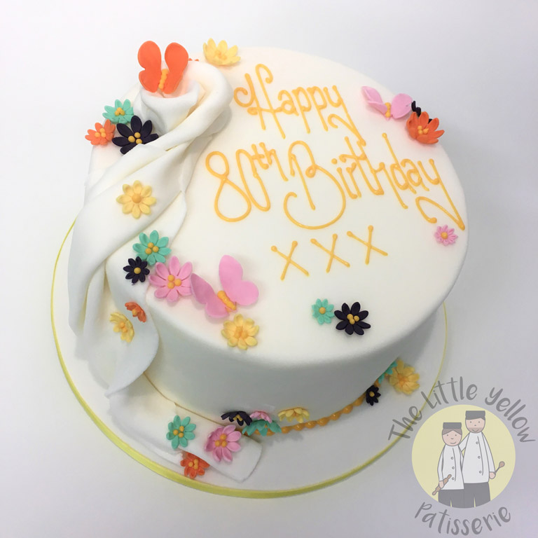 The Little Yellow Patisserie Cakes (White cake with flowers, writing and butterflies on top)