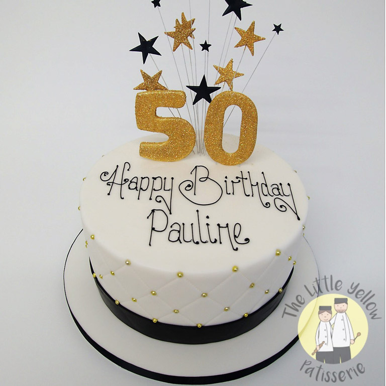 The Little Yellow Patisserie Celebration Cakes (White cake with large gold 50 on top and stars)