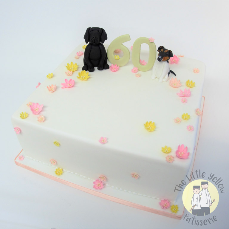 The Little Yellow Patisserie Cakes (Square white cake with fondant flowers and two dogs on top)
