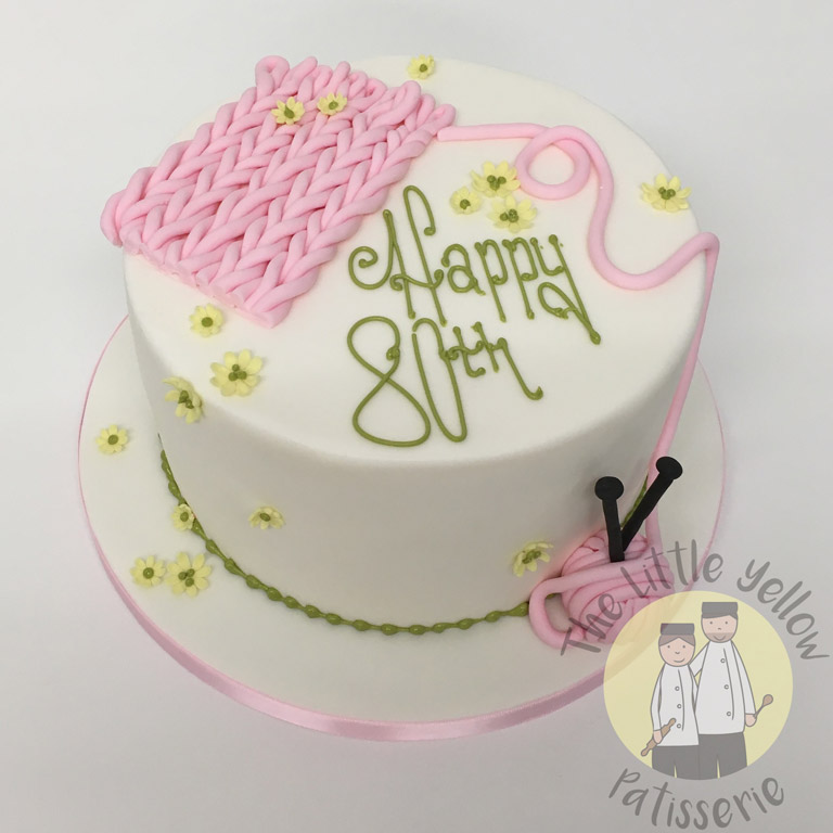 The Little Yellow Patisserie Celebration Cakes (White cake with fondant knitting patterns on top)