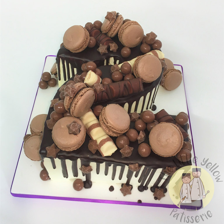 The Little Yellow Patisserie Celebration Cakes (Large cake in the shape of a 2 with chocolate decorations)