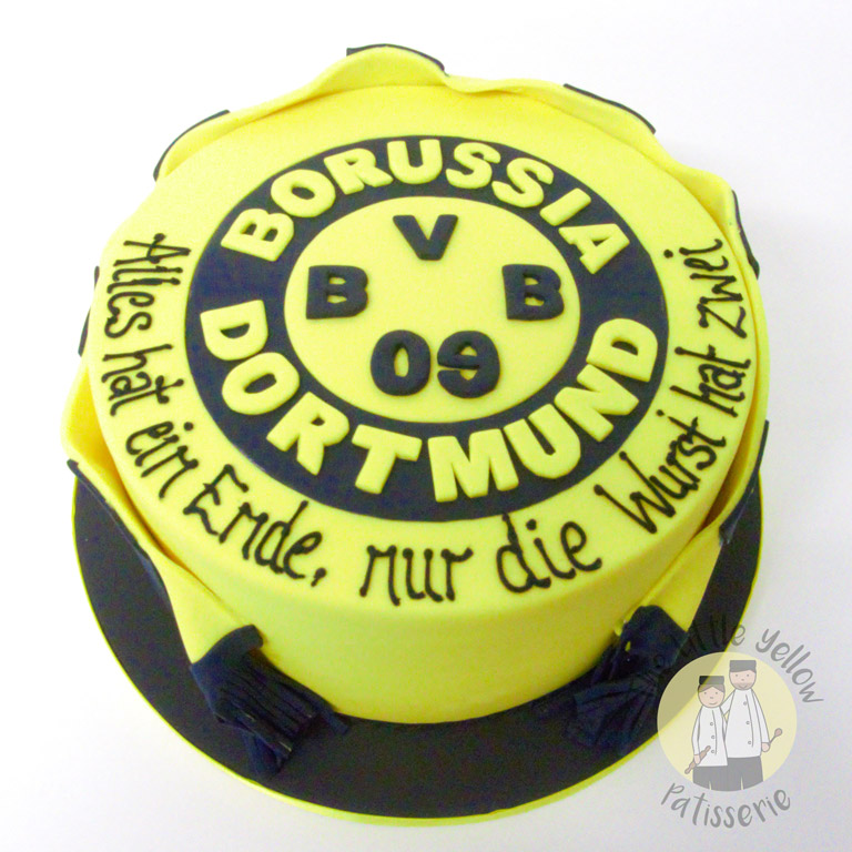 The Little Yellow Patisserie Celebration Cakes (yelllow cake with black writing in german on top)