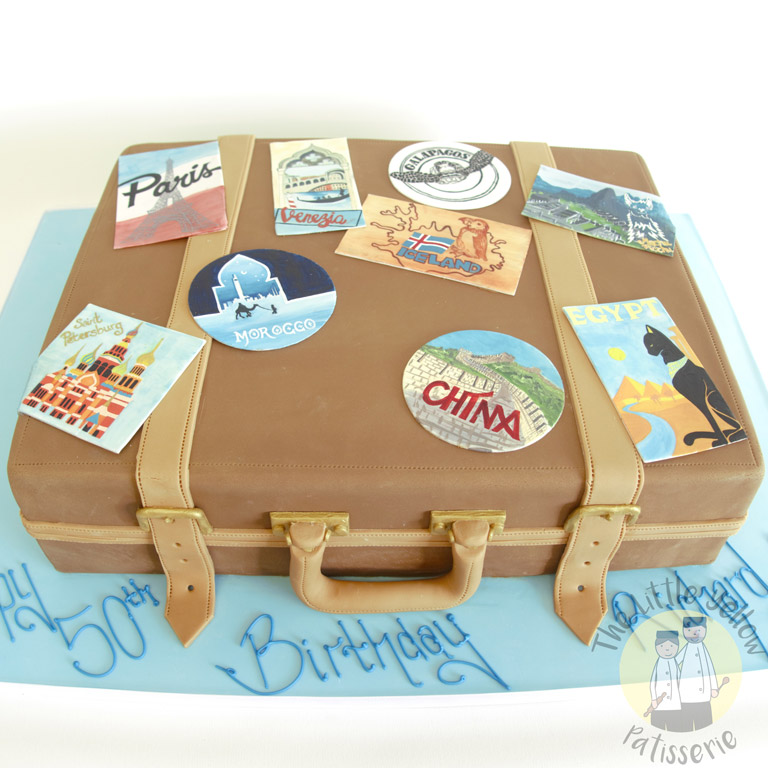 The Little Yellow Patisserie Celebration Cakes (large brown cake in the shape of a suitcase)