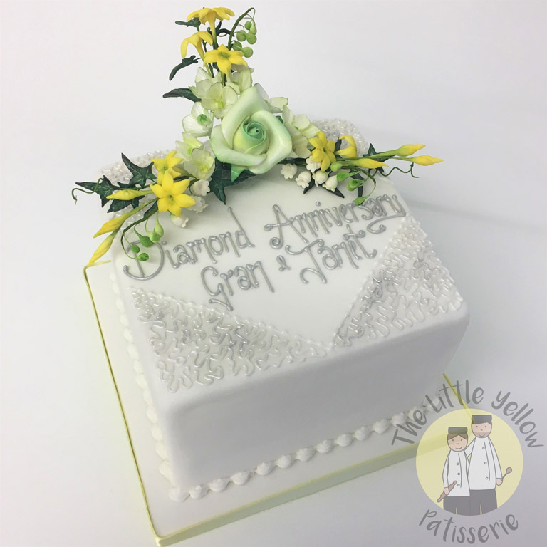 The Little Yellow Patisserie Celebration Cakes (Square anniversary cake with green and yellow fondant flowers)
