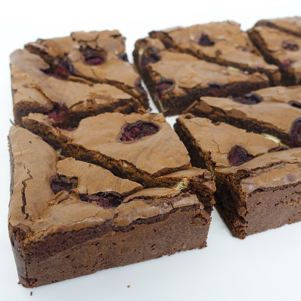 The Little Yellow Patisserie Raspberry Brownie (brownie triangles with raspberry chunks)