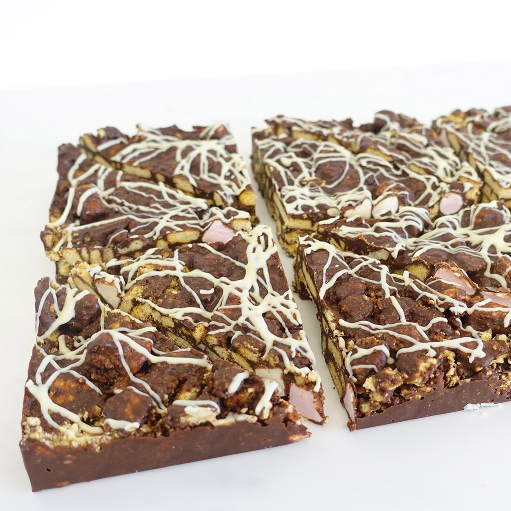The Little Yellow Patisserie Rocky Road (rocky road triangles drizzled with white icing)