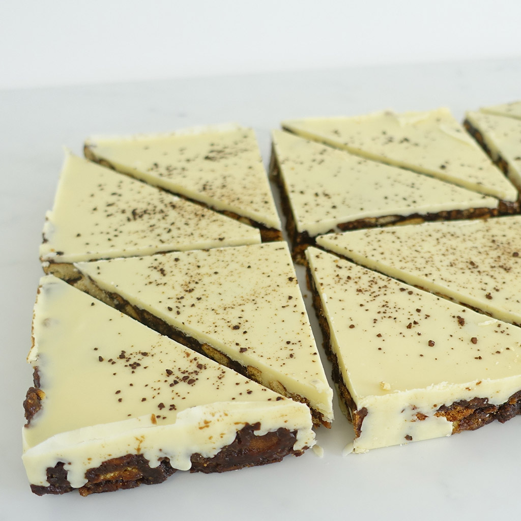 The Little Yellow Patisserie Biscoff Coffee (white chocolate covered triangles of tiffin)