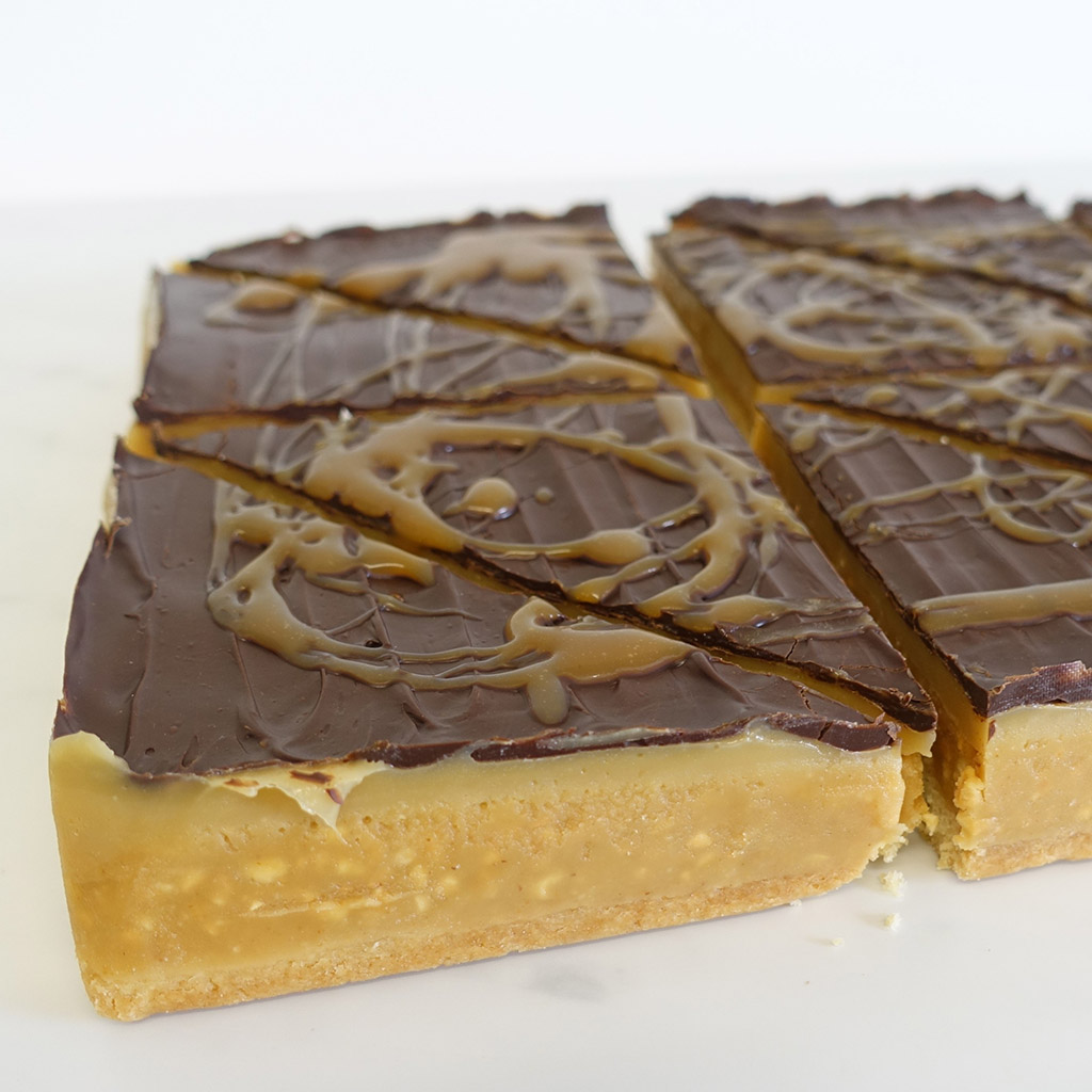 The Little Yellow Patisserie Peanut and Salted Caramel (triangles of layered shortbread with chocolate and caramel)