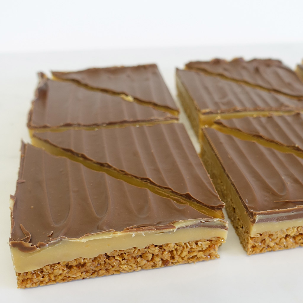 The Little Yellow Patisserie Caramel Flapjack (triangles of flapjack layered with caramel and chocolate)