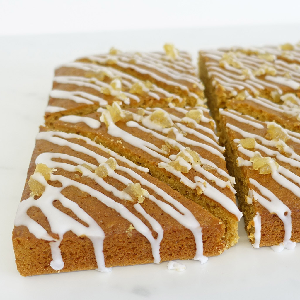 The Little Yellow Patisserie Stem Ginger Traybake (triangles of ginger sponge drizzled with white icing and stem ginger chunks)