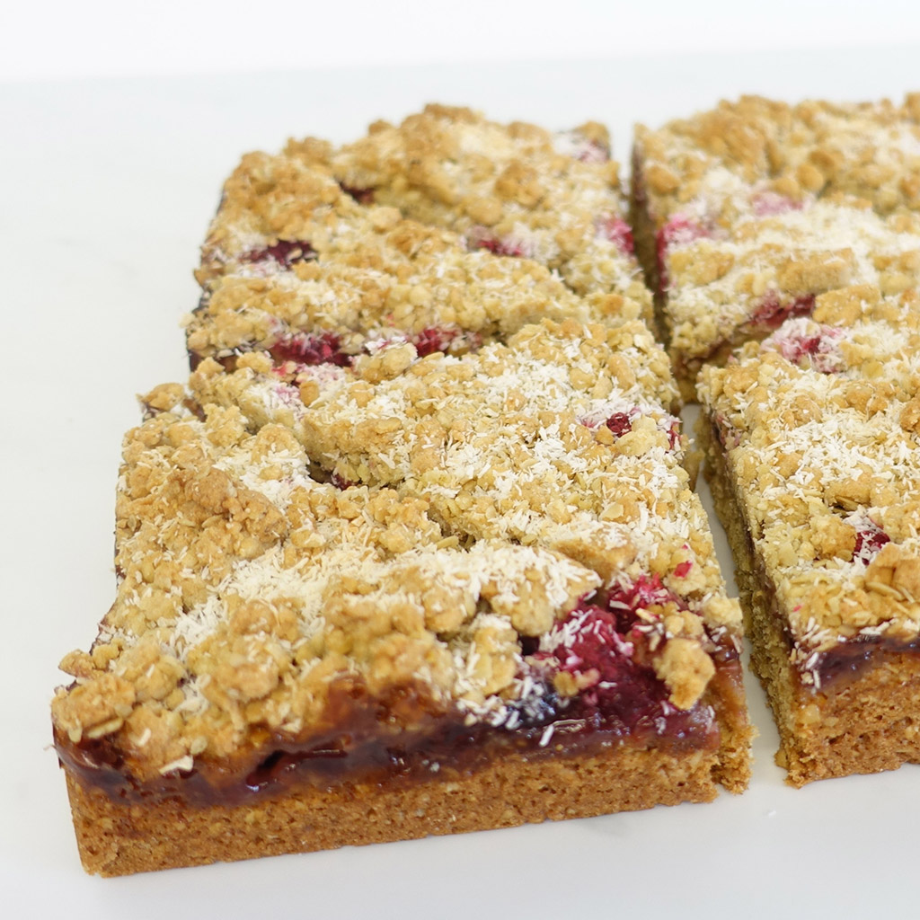 The Little Yellow Patisserie Raspberry and Coconut Tray Bake (triangles of flapjack with raspberry and coconut flakes)